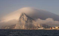 Clouds form over Gibraltar, seen from from La Linea de la Concepcion, Spain