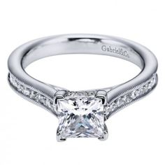 Princess cut engagement ring with channel set side stones and unique  details. I love this ring - it's so pretty!