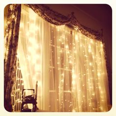 Love the lights with the sheers...it's very whimsical :)