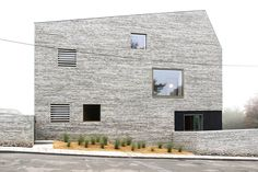 precast concrete lintels with bulging grout: Wall House by And'rol (Brussels, Belgium)