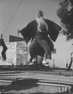 size: Photographic Print: Elderly Japanese Movie Extra Jumping on Trampoline by Ralph Crane : Artists Trampolines, Shes A Keeper, Look At The Stars, Life Magazine, Black And White Photography, Professional Photographer, Decir No, Things That Bounce, Youtube