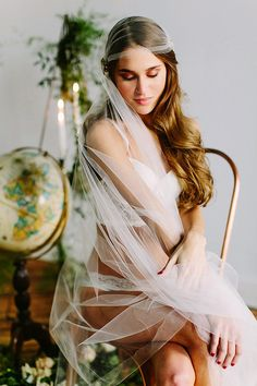 bohemian boudoir, photo by Claire Loves Love http://ruffledblog.com/editorial-boudoir-shoot-with-bohemian-styling #boudoirphotography #bridal #veil