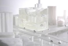 BIG Unveils Gigantic Cube Building with a Rooftop Park