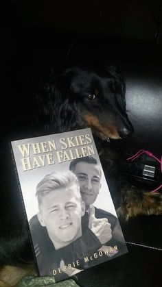 Klaus O'Tierney models the When Skies Have Fallen Paperback! :)
