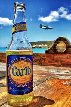 Cheers! by Katie S, via 500px  - Carib Beer