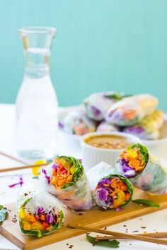 These Fresh Spring Rolls are a colorful, crunchy vegan meal that are perfect for a light lunch, dinner or appetizer! They are served with an amazing Peanut Ginger Sauce and are gluten free! Vegetarian Spring Rolls, Vegetarian Recipes, Cooking Recipes, Delicious Recipes, Spicy Almonds, Fresh Spring Rolls, Summer Rolls, Vegetable Spring Rolls, Ginger Sauce