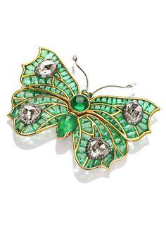 Emerald and diamond brooch.