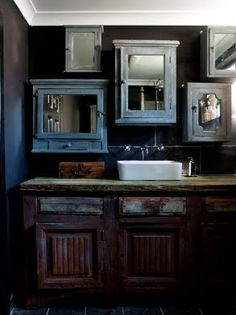 Bathroom storage with a difference--Use many antique medicine cabinets with mirrors :)