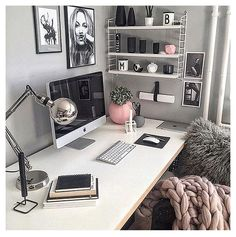 This DIY home office workspace makes me happy. It's not a bright white like the others, but the gray walls in this office paired with the white desk and the pink office decor and feminine office items just bring it all together perfectly. What a great work from home office idea!