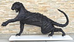 Recycled Tire Sculpture!!!! Life size Cougar made completely out of tires!!!  Animal Statue Sculpture!! by blakemcfarland on Etsy https://www.etsy.com/listing/222508748/recycled-tire-sculpture-life-size-cougar