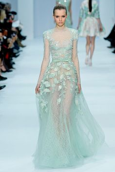 i am absolutely bowled over by the Elie Saab Spring 2012 Couture collection. So ethereal, so delicately organic... Just mesmerizing.