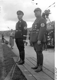 Himmler, rising head of the SS, and Captain Ernst Röhm, chief of the SA, attend an athletic meet of the SS in 1933. Almost a year after this photo was taken, Himmler dispatched the killers who butchered Röhm and other key SA leaders during the Night of the Long Knives.