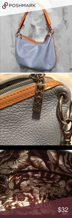 Maxx New York Blue Pebbled Leather Purse Maxx New York Blue Pebbled Leather Purse. Nice clean condition! A few scuffs an strap see pics. Also pen mark inside see pic, other than that it's a great looking purse! Perfect for spring/summer! Maxx New York Bags