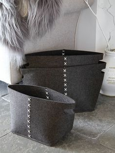 These striking graphite grey storage baskets will adorn any space.