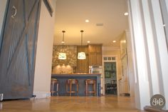 Sliding barn door for equestrian flair in the home. JulieBovaKitchen