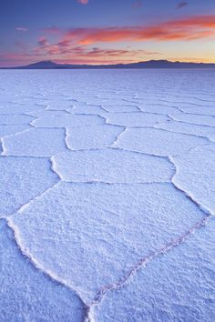 Sunrise over the Salar de Uyuni, the world's largest salt flat, in Bolivia Bolivia, Luxury Travel Agents, Nature Architecture, South America Travel, Once In A Lifetime, Free Travel, Mountain Landscape, Places Around The World, Trip Planning