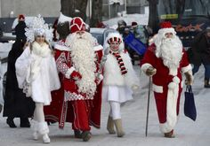 Father Frost (second from left), with his snow maiden, meets with Santa Claus (right) at the Nuijamaa border station between Finland and Russia in Lappeenranta, Finland, on December 23, 2012. Description from darkroom.baltimoresun.com. I searched for this on bing.com/images