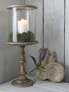 This large Danish hand-crafted mango wooden hurricane lamp is a natural centrepiece.