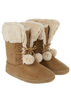 With lace-up details and cute pom poms, our suedette slipper boots ace the snug and stylish look. This ankle design features a faux fur lining for a super-so...