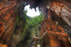 A temple deep in the Batu caves. - Imgur