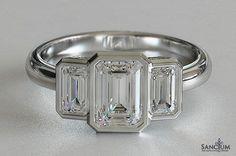Bezel set emerald cut engagement ring