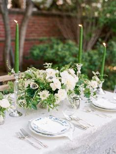 Green and Ivory Centerpiece with Taper Candles | photography by http://www.michelehartphotography.com