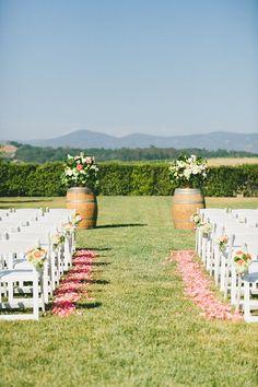 Outdoor wedding ceremony with barrels