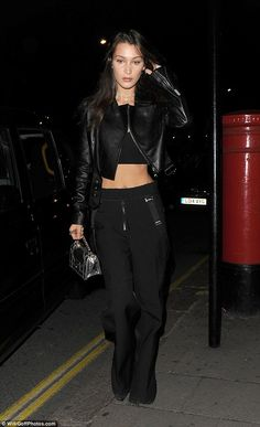 Off duty: Bella Hadid took a night off from the London Fashion Week runway on Sunday night for a more casual night out in the UK capital