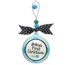 "Jumbo, hand-painted ceramic ""Baby's First Christmas"" Ornament with beaded hanger tied with grosgrain ribbon."