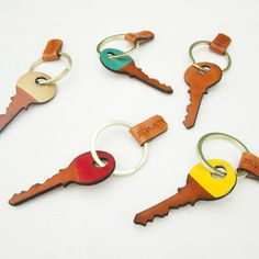 "Who wants another key on their keychain, right?  Well, maybe if it was this particular beautiful leather key, laser cut and hand painted/stained.- Approximately 3"" - 1.5"" brass split ring- 1/8"" durable cowhideBY ERIN SMITH * This item is made to order within 2 weeks. Please note that your entire order will ship within this time."