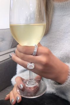 What is better than wine and diamonds? Especially with a huge emerald cut diamond engagement and a an emerald cut anniversary band #emerald #emeraldcut #diamond #engagementring #anniveraryband #diamonds #wine