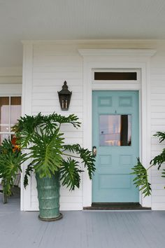 Gorgeous pale blue front door with a transom window above it! Plus tall aqua planter pot filled with tall tropical plants! Very summer style! Just add a wonderful door mat for sandy feet! Front Door Plants, Glass Front Door, Front Door Decor, Front Porch, Tropical Front Doors, Door Knobs Crafts, Old French Doors, Interior Wall Colors, Farmhouse Front