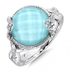 To command attention, just raise your hand. Bright fused turquoise, white diamonds and sterling silver