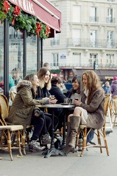 Group of girlfriends catching up over coffee in European cafe Via Tumblr