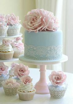 Powder blue wedding cake with petal pink rose flower accents and matching cupcakes!