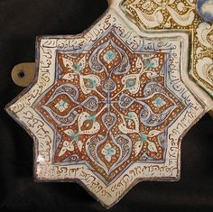 Star-Shaped Tile Object Name: Star-shaped tile Date: 13th–14th century Geography: Iran, probably Kashan Culture: Islamic Medium: Stonepaste; inglaze painted in blue and turquoise and luster-painted on opaque white glaze