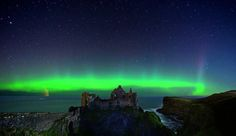 This is Dunluce Castle Co.Antrim(Ireland) with The Northern Lights overhead. - Imgur