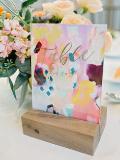 modern art abstract colorful painted table numbers | Photography: Elizabeth Marie Weddings + Events