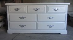 7 drawer dresser hand painted and refinished in white with silver hardware.  Done by Kelly's Creations.  Like us on facebook! http://www.facebook.com/pages/Kellys-Creations/524028237619793