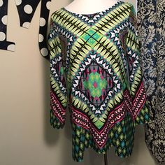 Multicolored and multi patterned bell sleeve top! Mini dress or shirt! Gorgeous colors and patterns! Throw on with some leggings or skinny jeans and go! Very vibrant...so if you want to stand out, get noticed and complimented...this is for you! Tops