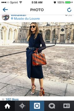 Olivia Palermo in strappy wrap heels, double belts, black and a croc satchel at the Louvre, Paris Fashion Week