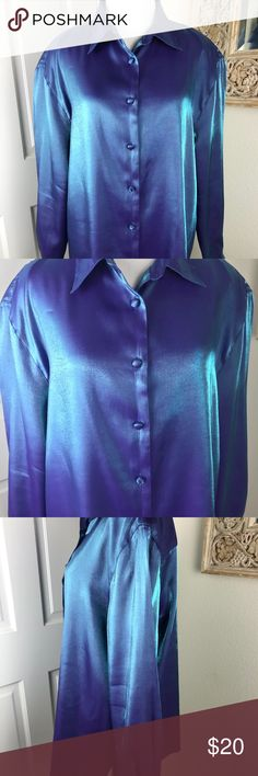 """Holiday Glamour Shimmer & Shine Karen Scott Blouse Gorgeous Karen Scott Blouse from Macy's in an iridescent Blue/Purple metallic fabric. Really stunning with covered buttons on front and cuffs. Straight hem, would be great with tuxedo pants and strappy heels!  Pit to pit measured flat 23"""", back length 26"""". In beautiful condition but please note that metallic fabrics come with some fabric inconsistency as the threads are fragile. Excellent condition as photographed. Karen Scott Tops Blouses"""