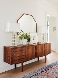 You need to see jewelry designer Jennifer Meyer's midcentury-modern-meets-bohemian home renovation courtesy of One Kings Lane—the result is a cozy and inviting space speckled with California style and feminine touches. This credenza and mirror combo make Retro Interior Design, Mid Century Interior Design, Sweet Home, Retro Home Decor, Home And Deco, Modern House Design, Modern Houses, Small Houses, Home Decor Inspiration