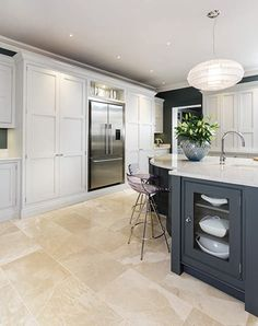 This sleek painted kitchen is a contemporary twist on a traditional shaker style featuring bespoke cabinetry and dark oak kitchen dresser. Open Plan Kitchen Living Room, Kitchen Family Rooms, Home Decor Kitchen, Kitchen Interior, Home Kitchens, Kitchen Ideas, Kitchen Dresser, Kitchen Paint, Kitchen Tile
