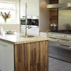 The Mercury range cookers in stainless steel are a perfect choice for creating a crisp contemporary look in the kitchen. The beautiful walnut side panels and high gloss white units in this shot compliment the supreme quality Mercury finish perfectly.