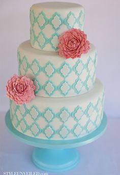 Teal and coral wedding cake.