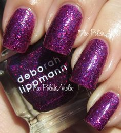 Deborah Lippmann Flash Dance- is small bright purple glitter and larger red glitter in a magenta jelly base.