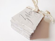 """""""super-thick, Italian cotton papers with a deckle edge, a gray watercolor wash on each card, and black ink for the calligraphy"""" – Stephanie Fishwick"""