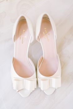Pretty white open toe kitten heel with a bow Kate Spade Bridal Wedding shoes. Photo by Weddings by Christopher & Nancy, Wedding Planning by Bella Baxter Events.