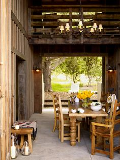 Outdoor dining space with table set made of reclaimed wood. #design #decor